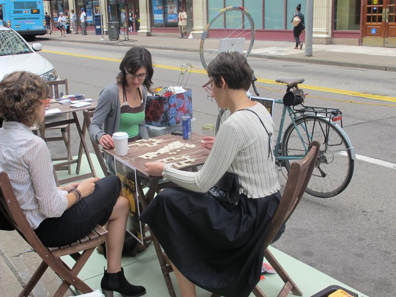 Volunteers at the Bike Pittsburgh parking space play games.