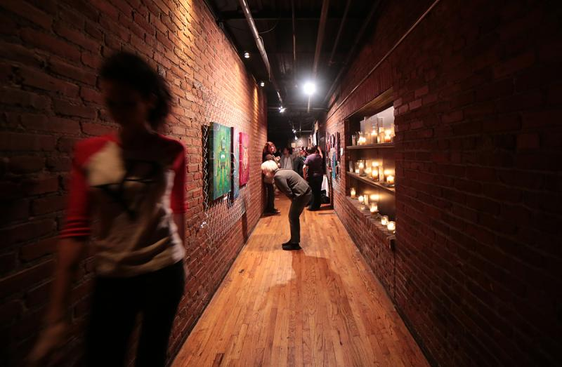 Patrons enjoy the latest RAW/Pittsburgh exhibition.