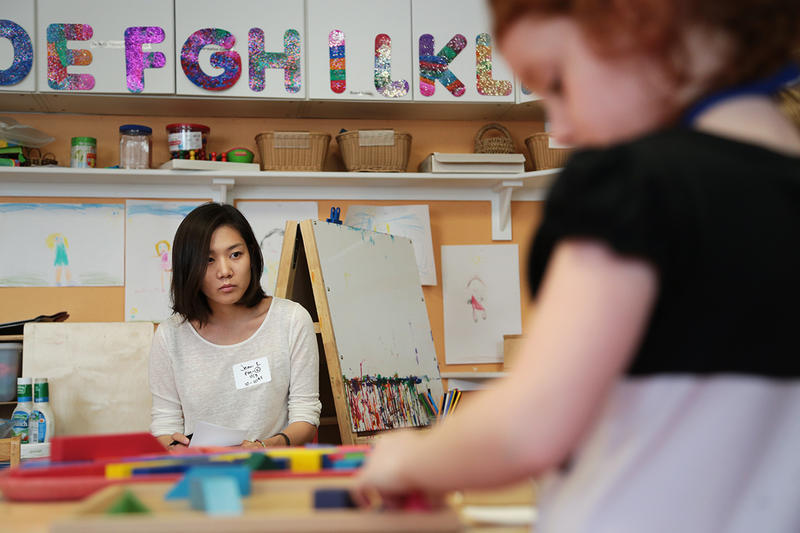 At the Children's School, Carnegie Mellon University student Jean Kwon observes a group of children playing with blocks as part of a child development course.