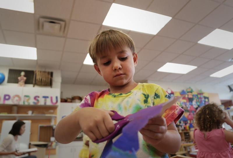 Five-year-old Clark Henne works on an art project.