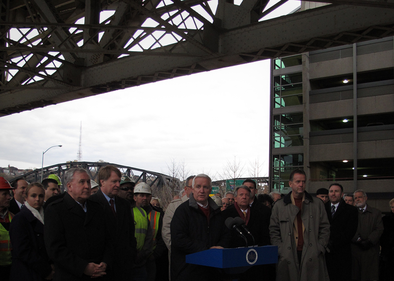 Gov. Tom Corbett speaks under Pittsburgh's Liberty Bridge about legislation that will provide funds for improvements to Pennsylvania's highways, bridges and mass-transit systems.