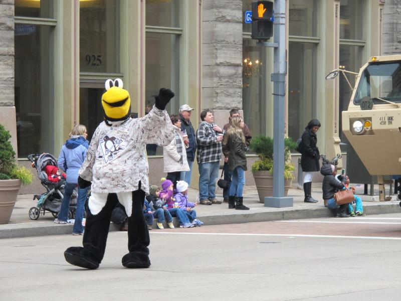 The Penguins' Mascot Iceburgh marches in the Veterans Day Parade
