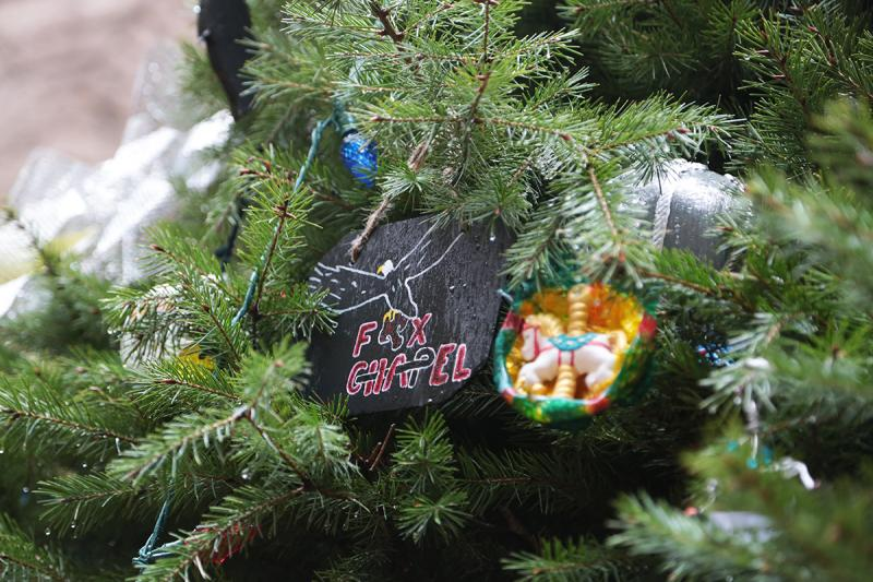 An ornament representing Fox Chapel hangs from the tree.