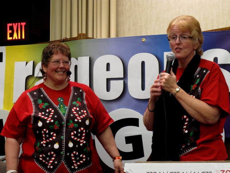 Couple Kathy Rizza and Cindy Shaffer perform a duet before the games begin.