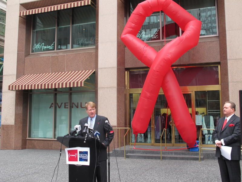 Allegheny County Executive Rich Fitzgerald speaks in front of the 30-foot ribbon balloon Downtown.