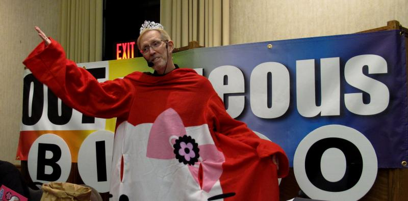 Caller Rick Allison models a door prize — a Hello Kitty Snuggie