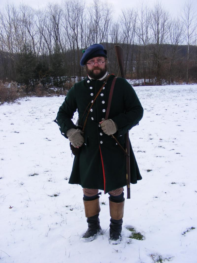Re-enactor Daniel Nehrer wears clothing similar to what Washington would have worn on his journey.