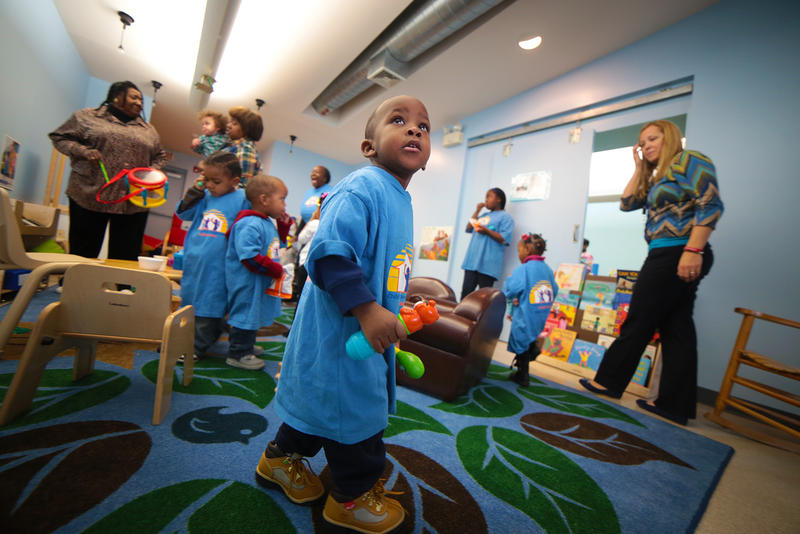 Two-year-old Khalil Kyte romps around a play area at the Homewood Early Learning Hub on a recent Tuesday. In addition to activities for kids, the Hub offers resources and training opportunities for childcare providers.