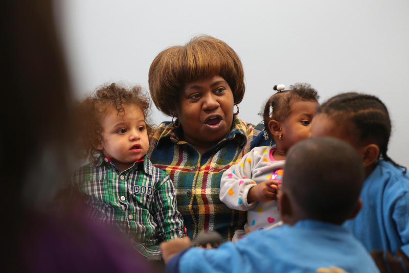 Rhonda Owens, who runs the Righteous Beginnings Learning Center in Homewood, participates in a play time at the Hub.