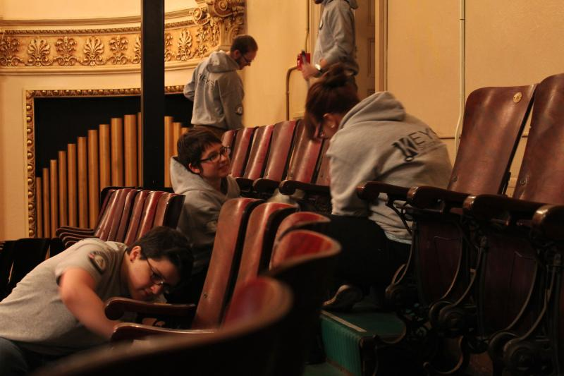 Members of KEYS Service Corps clean the seats of the music hall in the Homestead Carnegie Library in celebration of Martin Luther King day
