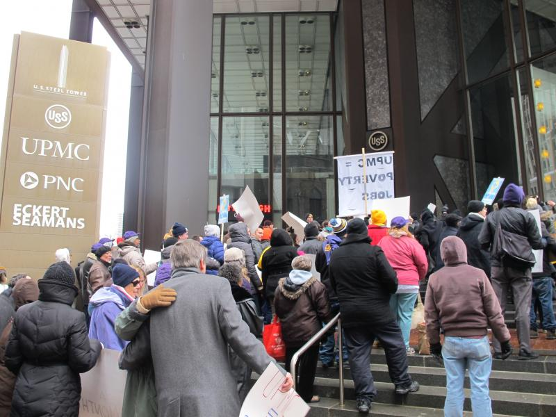UPMC workers and community activists rally outside UPMC headquarters in downtown Pittsburgh.