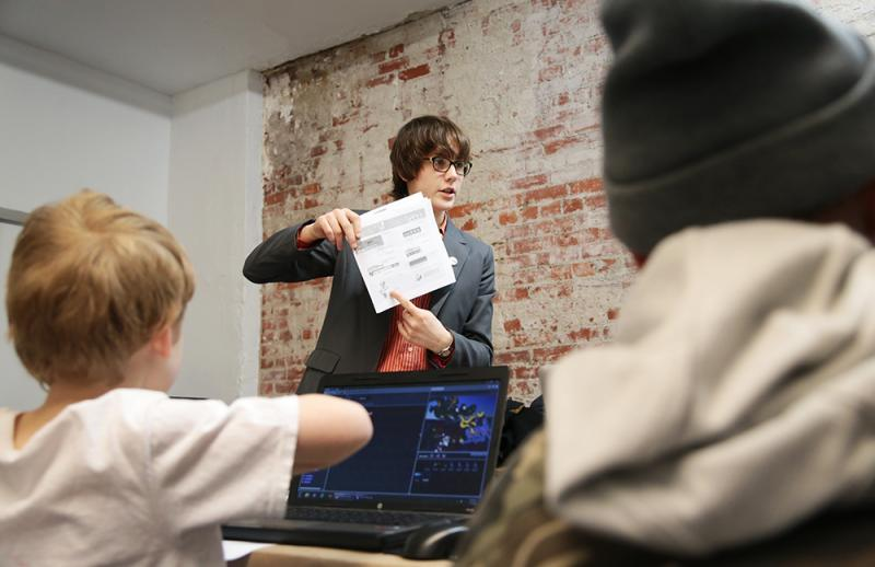 Fifteen-year-old Caroline Combemale teaches computer programming language Scratch during a recent session at Assemble Pittsburgh.