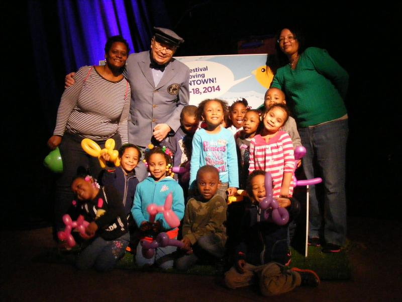 Children from Brightside Academy pose with Mr. McFeely.