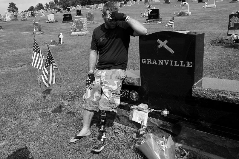 Joseph Granville suffered from PTSD and took his life on Dec. 18, 2010. Earl (pictured) visited his twin's grave at Our Mother of Sorrows Cemetery in Greenfield Township.
