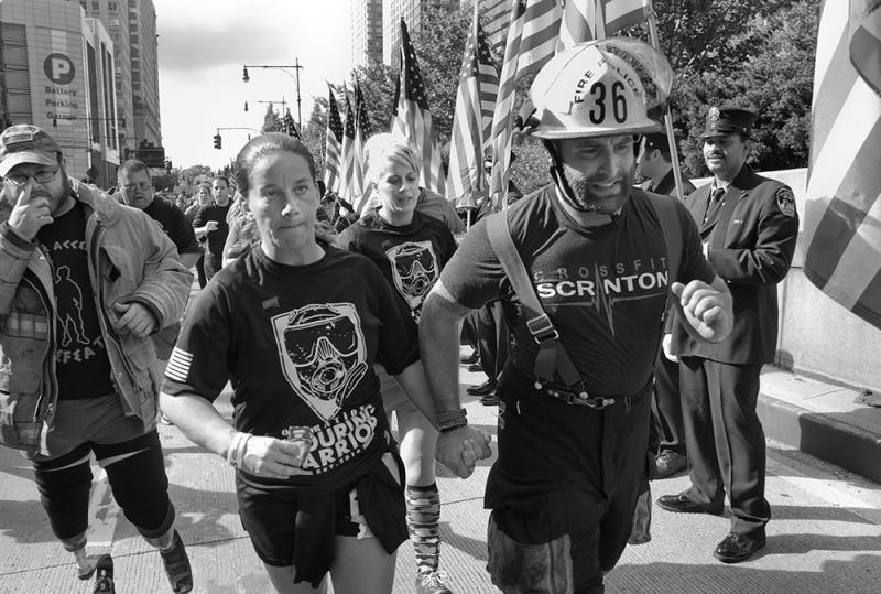 Paramedic Emily Prezzano of Westchester, N.Y., and Earl ran hand in hand on West Street in New York City during the Tunnel to Towers 5k.