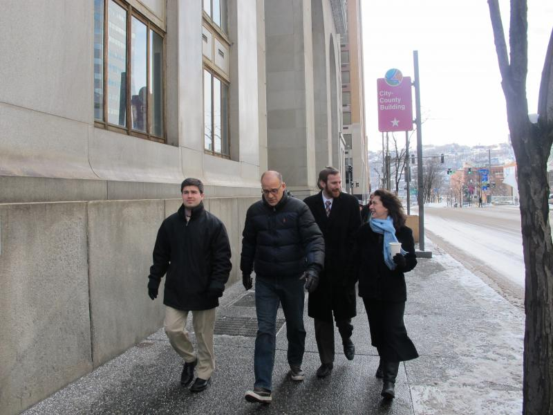 City Council representatives Corey O'Connor, Bruce Kraus, Dan Gilman, and Deb Gross walked from the City-County Building to the rally Monday.