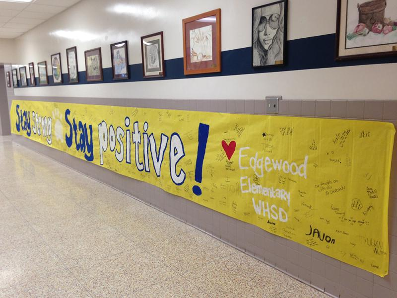 A banner with messages of encouragement from Edgewood Elementary hangs inside Franklin Regional High School.