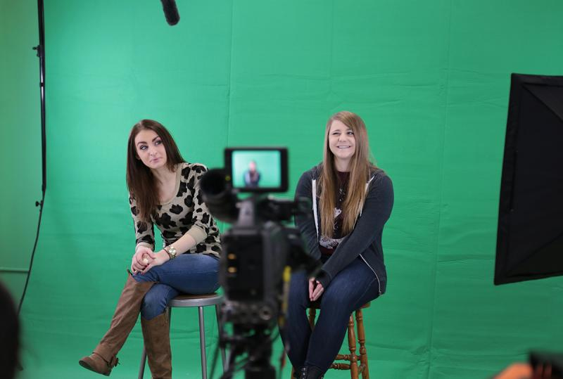 Sto-Rox seniors Morgan Scacchitti (left) and Emily Janicki anchor a daily television show from the school's Creative Media Technology Learning Center.