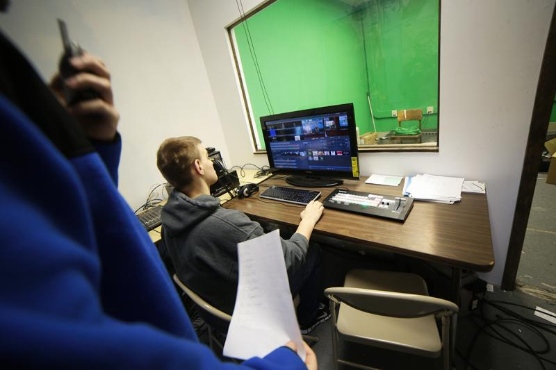 Junior Chase Dunham runs the control board for the school's daily television program.