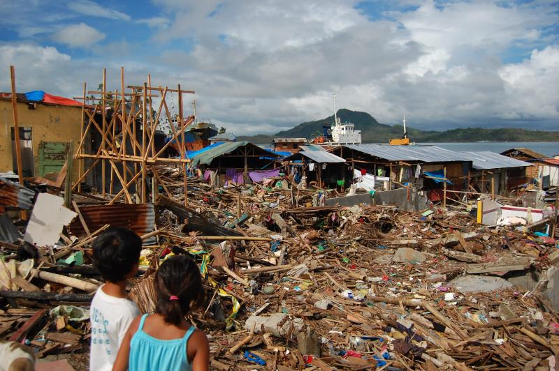 Two children look out across the Tacloban slum, which was badly damaged by typhoon Haiyan.