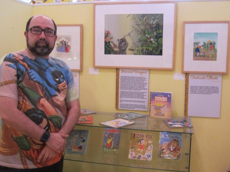 Museum director Joe Wos at one of the exhibits at the Toonseum