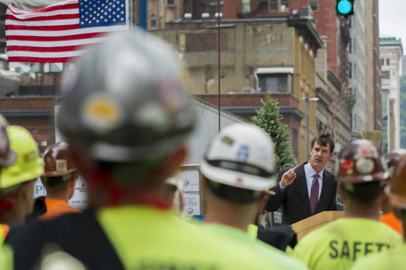 Bill Demchak, PNC chairman, president and CEO speaks at a ceremony marking the placement of the last steel beam atop the Tower at PNC Plaza.