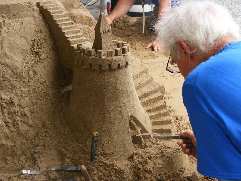 Sculptor Kirk Rademaker adds details.