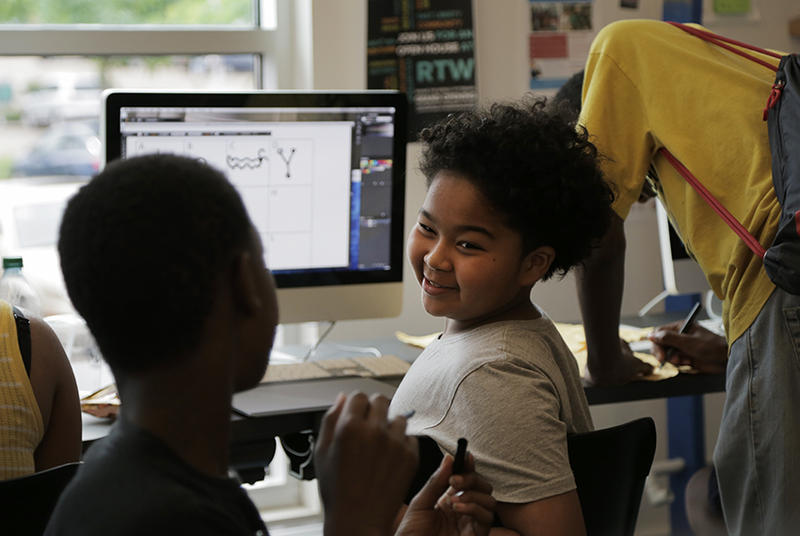 Using the graphic editing software Adobe Illustrator, 11-year-old Winston Bell participates in a lesson on ancient Egyptian hieroglyphics at The Labs at the Carnegie library's East Liberty branch.