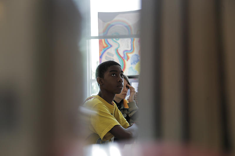Aveion Levert, 13, listens to a recent lesson on ancient Egypt at The Labs at the Carnegie library's East Liberty branch.