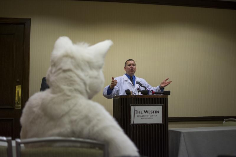 Samuel Conway, Anthrocon Chairman and CEO, greets the media (along with some with furries) during a news conference Wednesday.