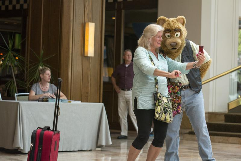 Rhubarb the Bear from Orlando, Florida poses with a hotel guest as Anthrocon gets underway on Wednesday at the Westin Convention Center hotel.