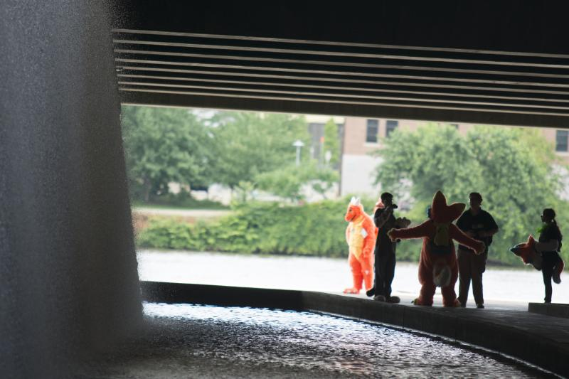 ​Furries take a moment for a picture outside of the David L. Lawrence Convention Center during Anthrocon.​
