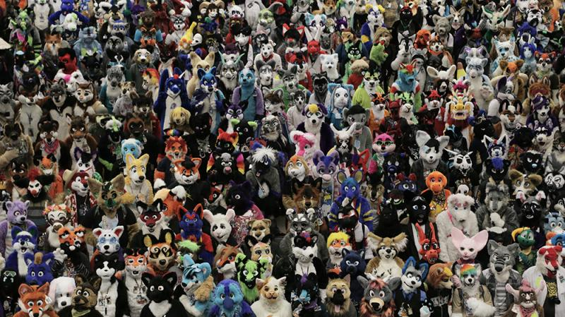 Hundreds of furries gather for a group photo Saturday at the David L. Lawrence Convention Center.