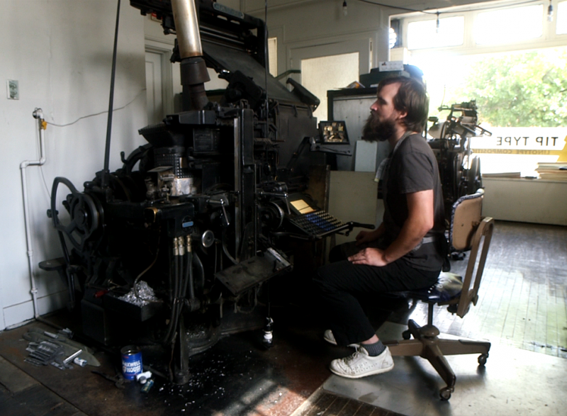 Boan works on a Model 5 linotype machine from the 1940s.