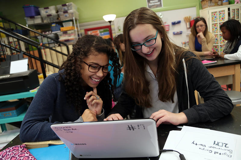 Tori Hogue (left) and Riley Wolynn, eighth graders at the Environmental Charter School at Frick Park, learn HTML in the school's Thinking Lab.