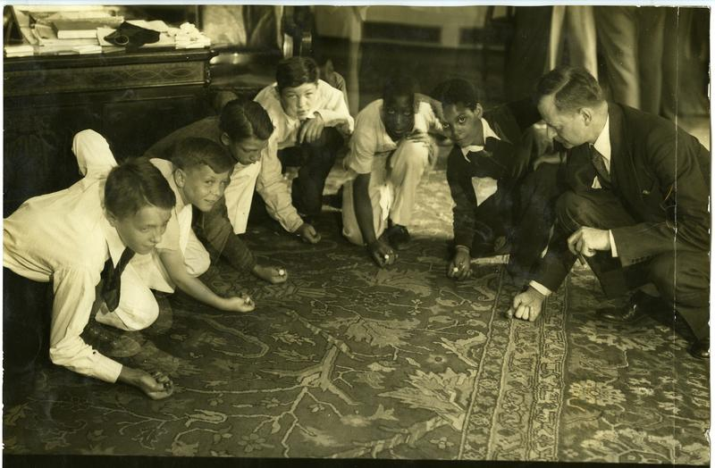 Mayor William McNair, who finished Kline's term, poses with the city's marble champions on the rug.