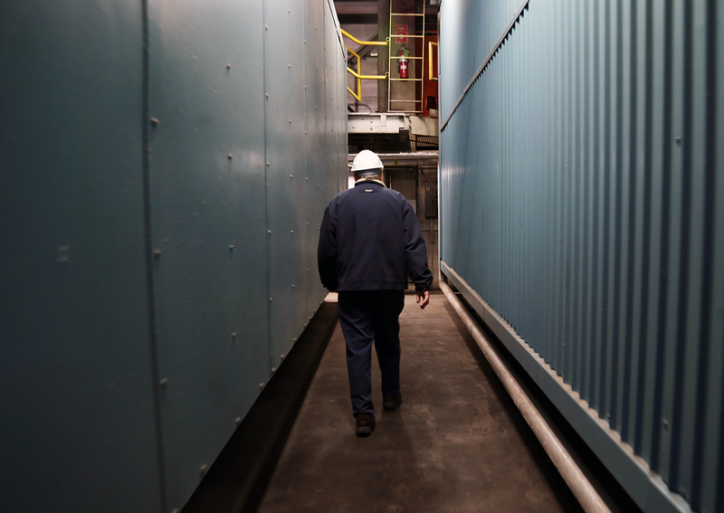 Bob Miller walks through the labyrinthine boiler plant.