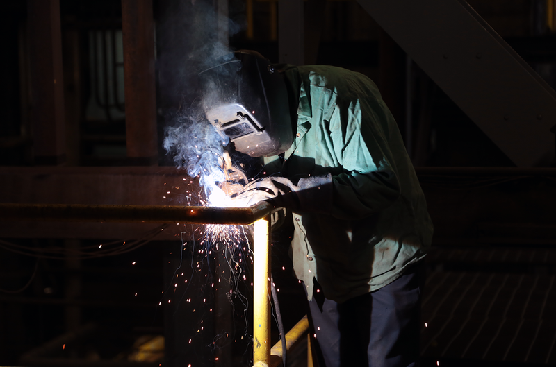 Repairman Roy Marzullo welds a handrail.