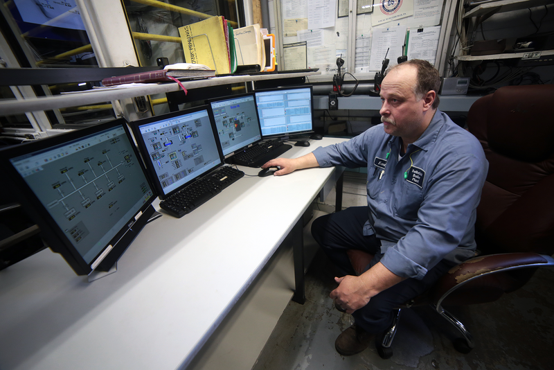 Engineer Kurt Freund monitors the plant's boilers in the control center.