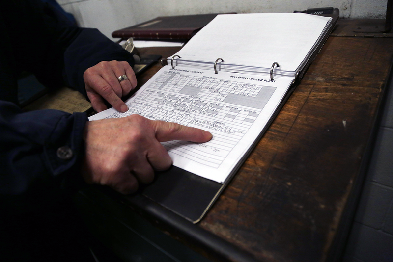 A record book keeps track of pH levels of boilers and polishers in the plant.