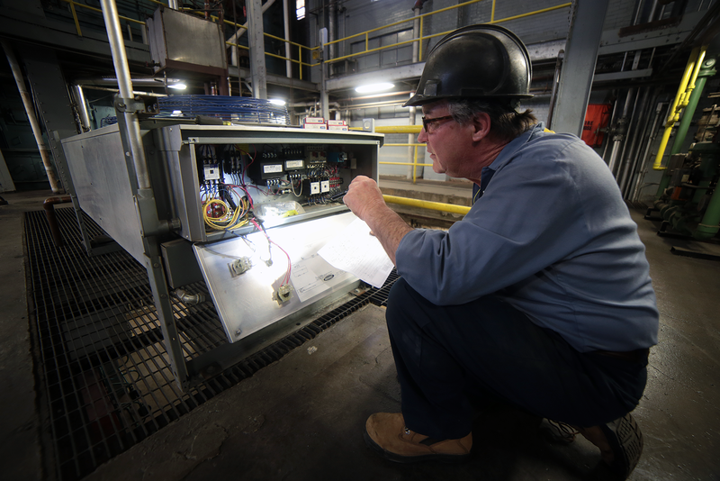 Electrician Joe McCafferty troubleshoots the controls of a closed-circuit cooling system.