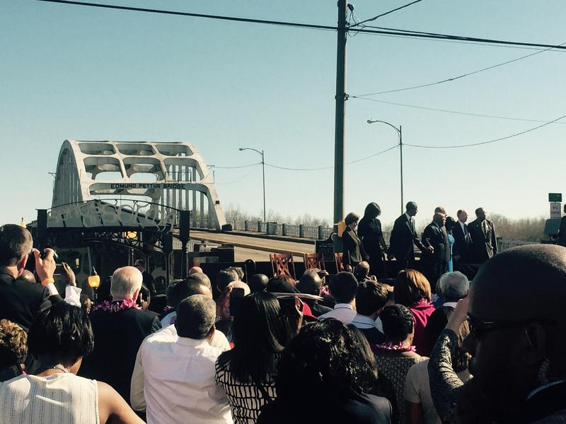 A view from the crowd in front of the Edmund Pettus Bridge over the weekend. President Obama and other national leaders stand on stage in the background.