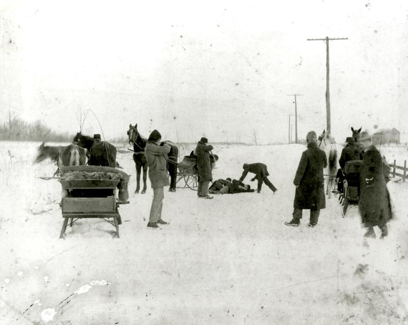 Escaped convicts Jack and Ed Biddle were ambushed by Allegheny and Butler County Police on February 1, 1902. The two brothers lay on the ground; Buck McGovern (to the left) points his rifle at them.