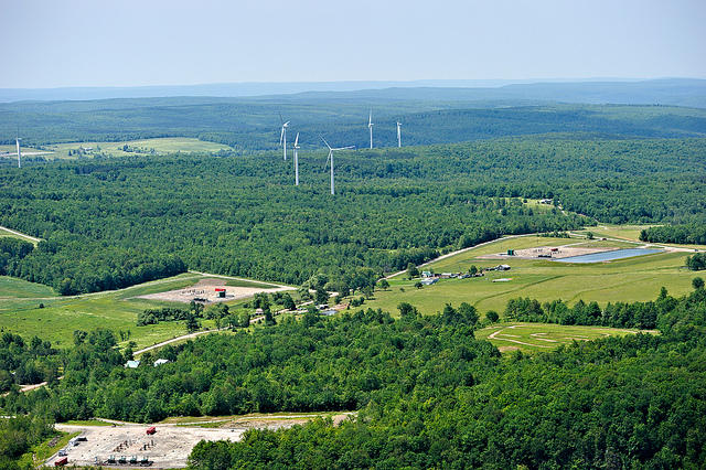 Three natural gas drilling sites located next to a windmill farm in Bradford County, PA.