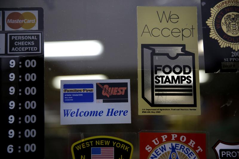 A supermarket displays stickers indicating they accept food stamps in West New York, N.J., Monday, Jan. 12, 2015.
