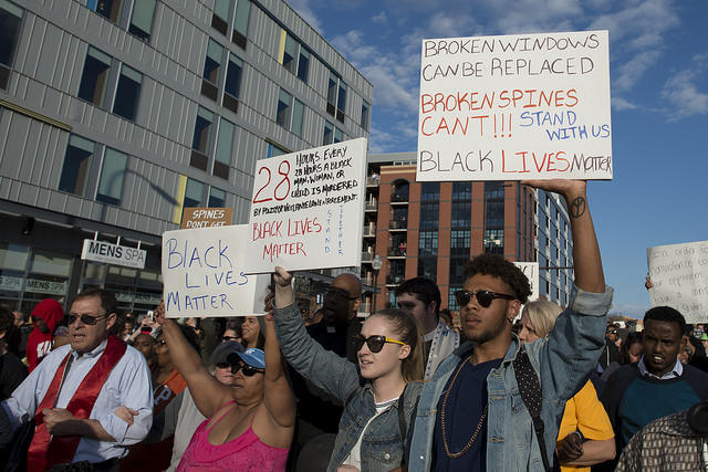 Protestors in Minneapolis show their support for the people of Baltimore, where 6 police officers have been charged with a number of crimes including murder and manslaughter for the death of Freddie Gray.