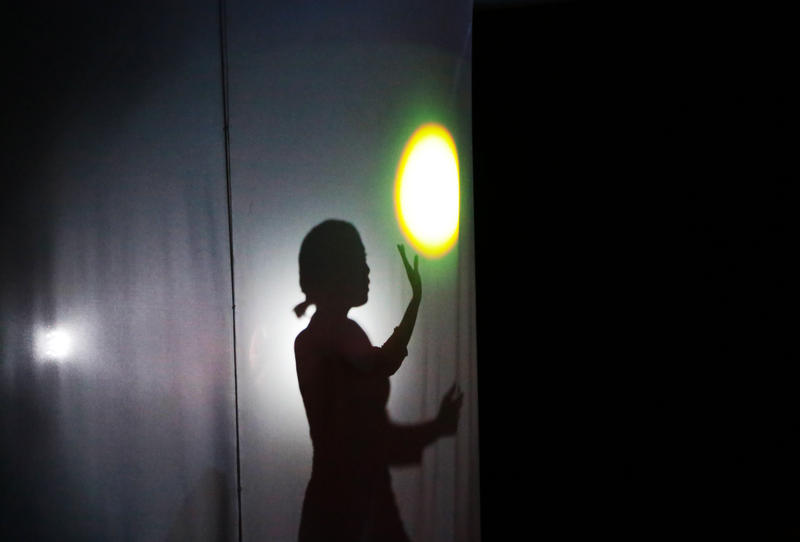 During the performance, actors from Teatro Al Vacio interact with light in different ways.