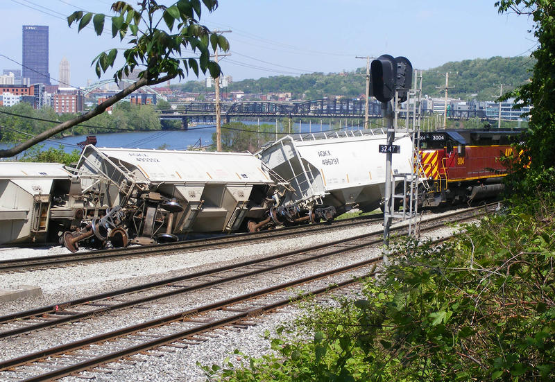 Thirteen empty freight train cars jumped the tracks in the Pittsburgh neighborhood of Hazelwood Thursday morning. No one was hurt.