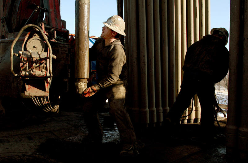 Patrick Place, left, a floor hand with Patterson UTI, and Steve Jager, a driller with Patterson UTI, work on a drilling rig contracted by Range Resources in Canonsburg, Pa, on Wednesday, Jan. 24, 2008.