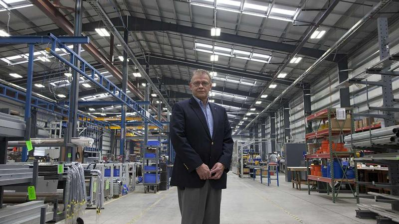 Mark Haley, President of Hormann Flexon, on the factory floor where workers produce high-speed doors. The company just moved to a new building, and Haley said finding a site that was already prepared and ready for vertical construction was essential.
